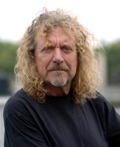 Robert Plant Signs His 10 Foot Gibson Les Paul Guitar